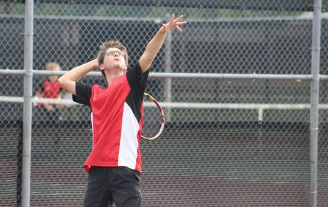 Varsity tennis begins district matches