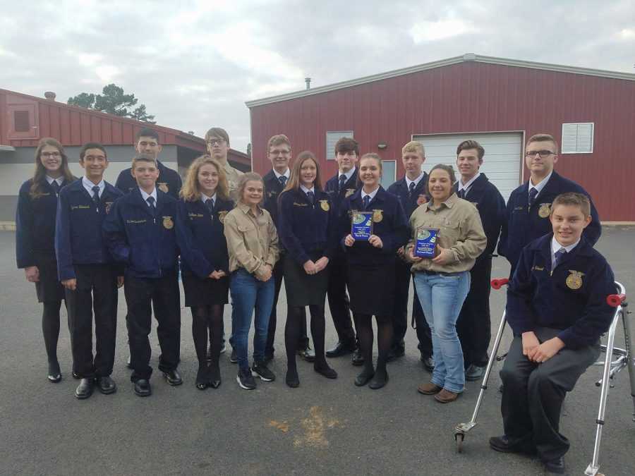 Kilgore FFA students pose for a picture with their awards.