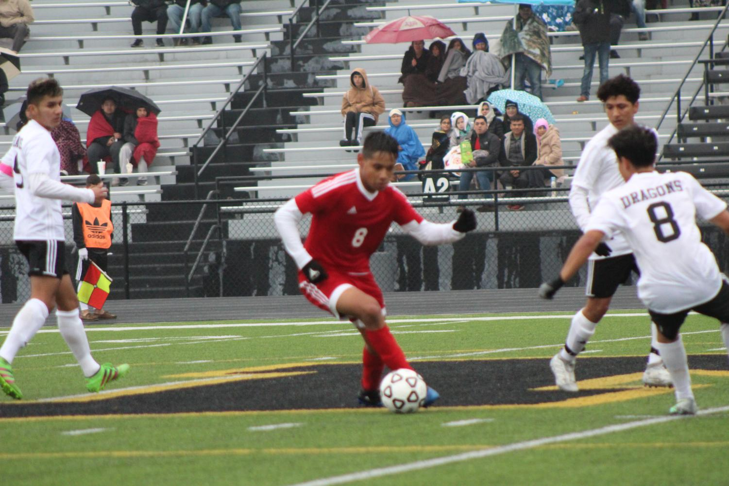 Junior Gavino Baldazo takes on defender.