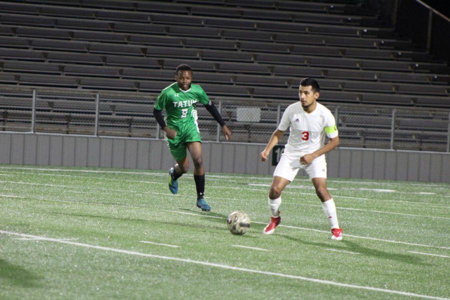 Senior+Jordi+Contreras+takes+on+a+Tatum+defender.