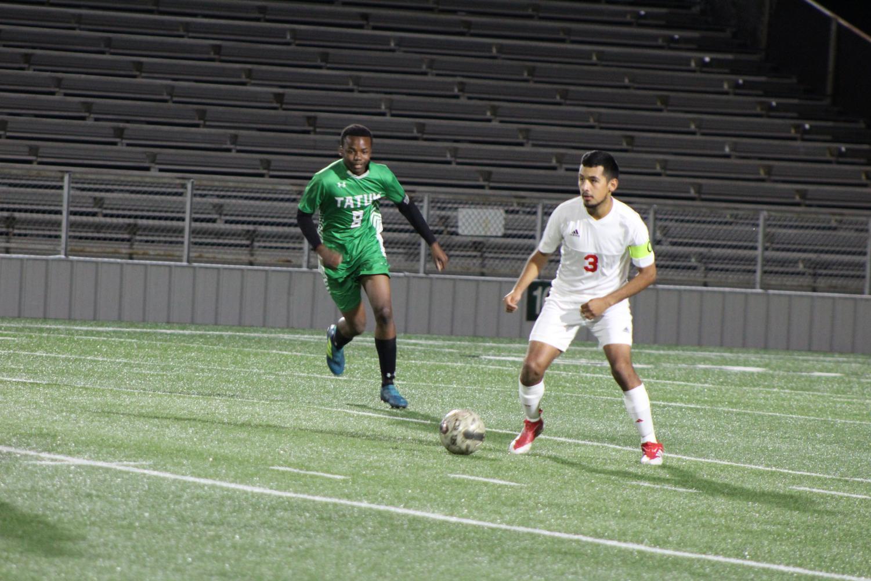 Senior Jordi Contreras takes on a Tatum defender.