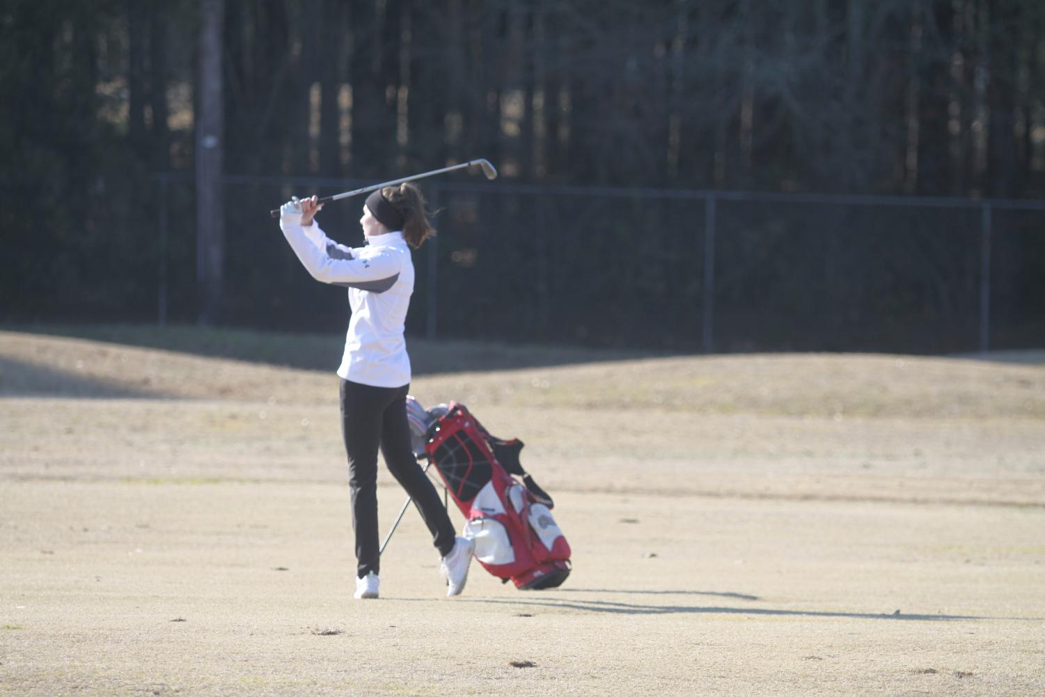 Sophomore Lauren Bryant putts the ball.