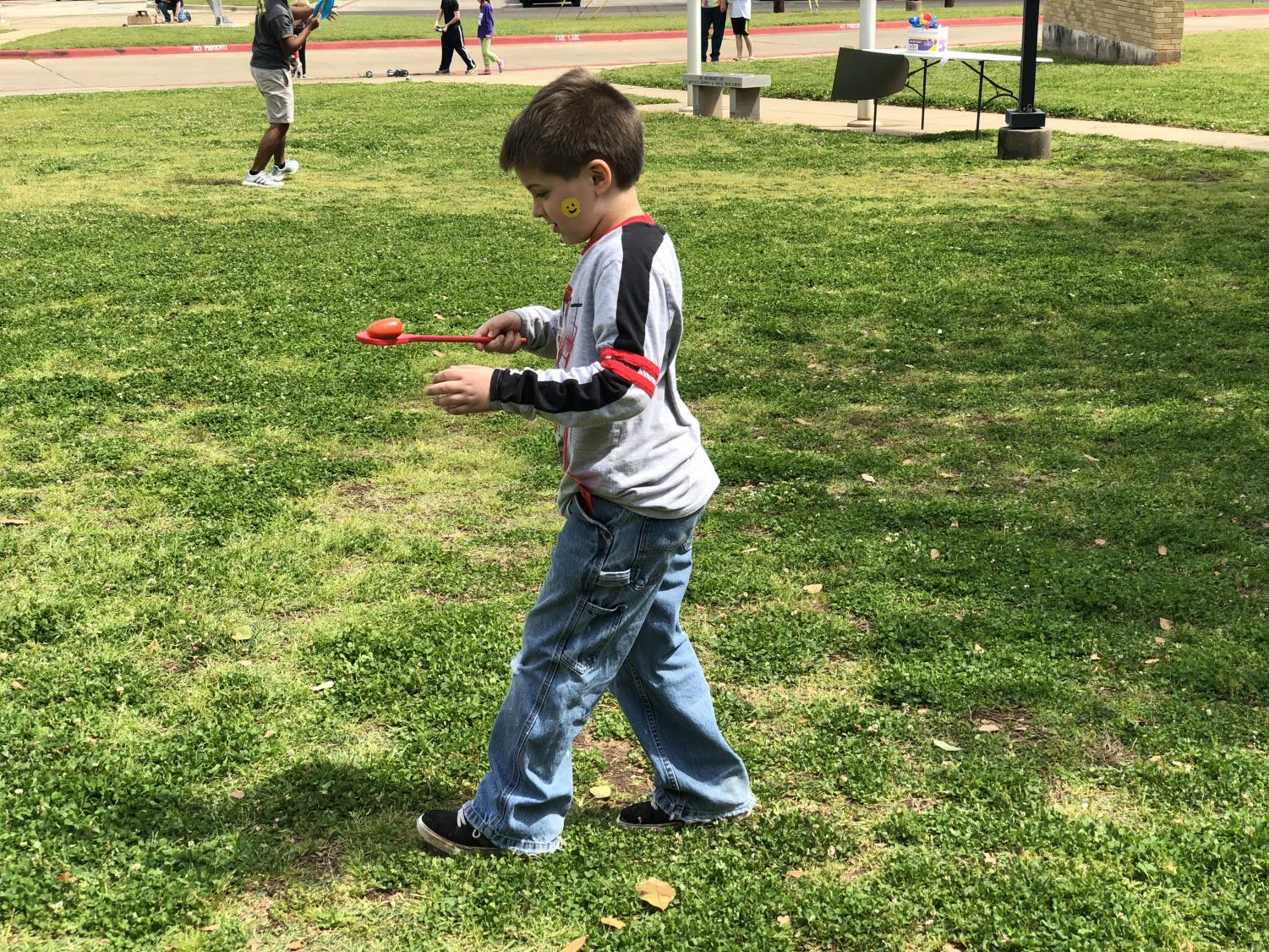 A student participates in the Egg Race.
