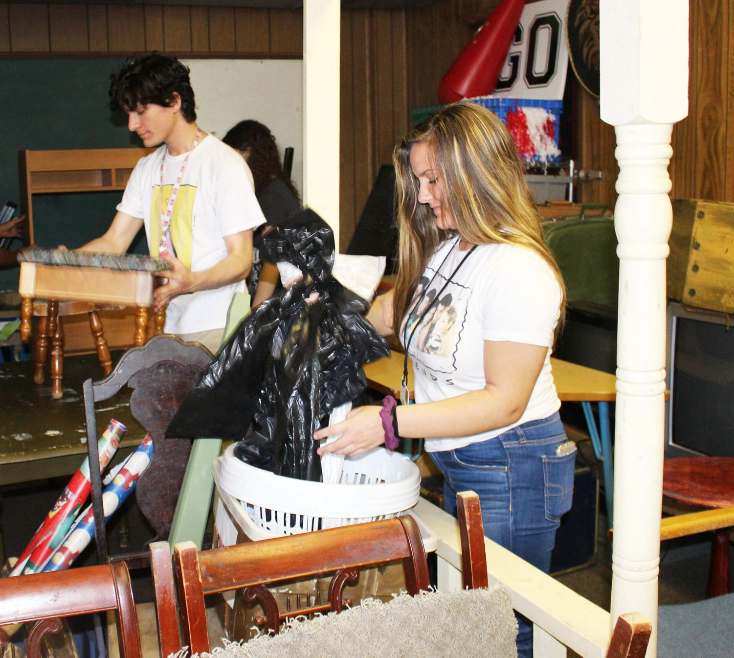 The theater department cleans out the prop room. Students are preparing for 'Into The Woods,' the fall musical.