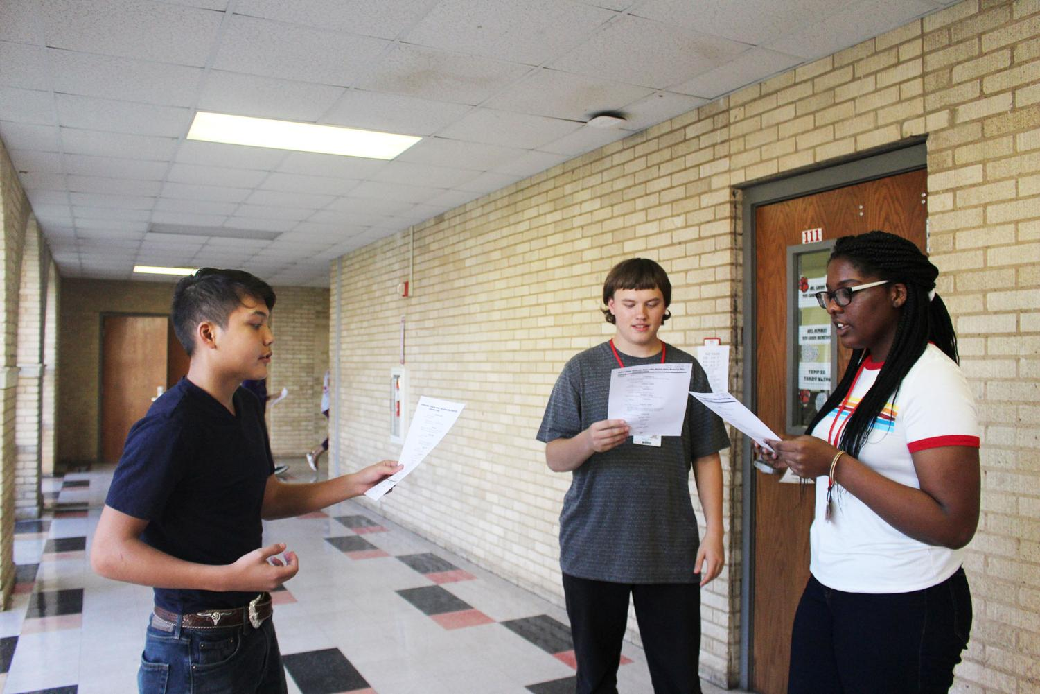 Freshman Bryan Harter, sophomore James Malick, and sophomore Brooklyn Hall practice their scene before auditions.