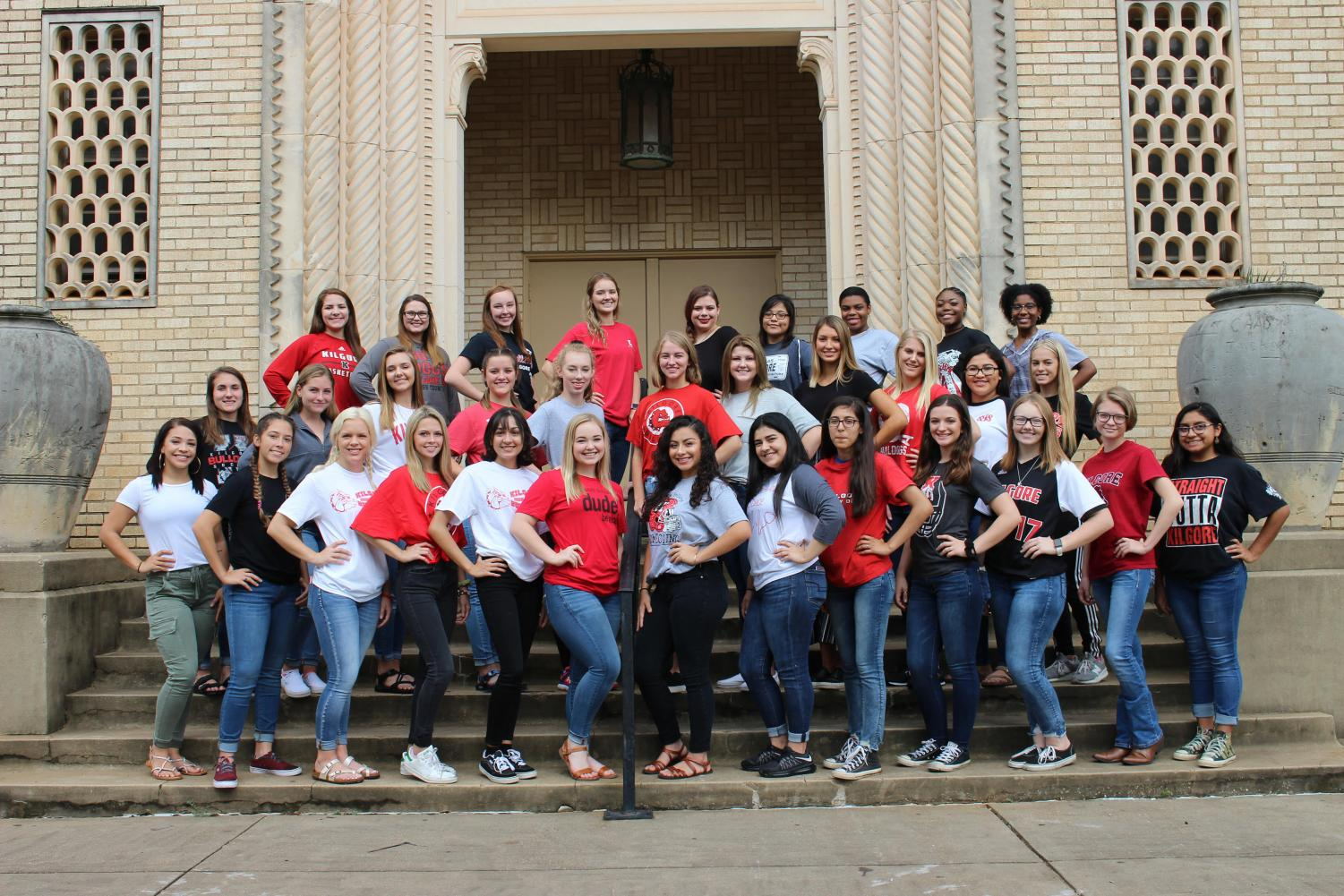 The 2018-19 homecoming duchesses gather in front of the school for a picture
