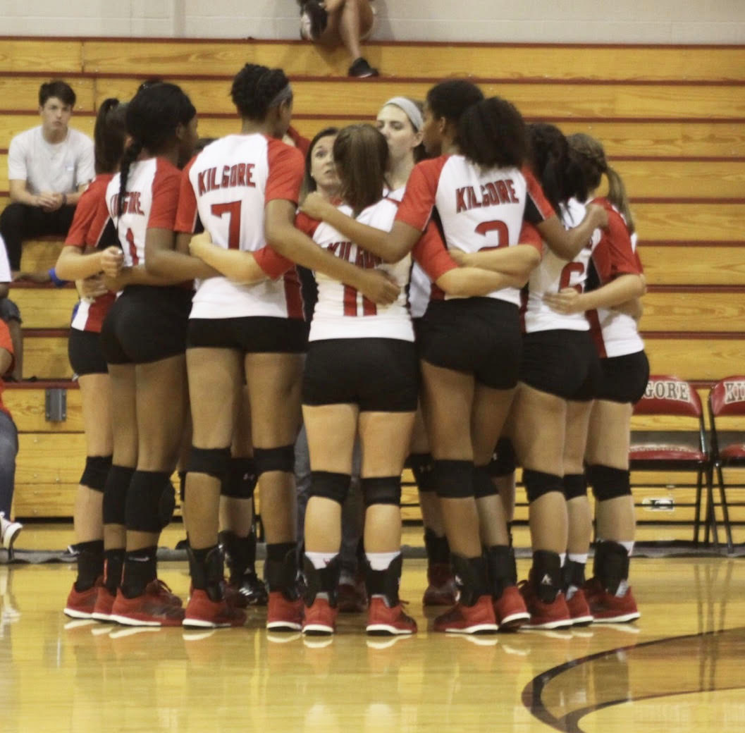 Varsity girls huddle during time-out.