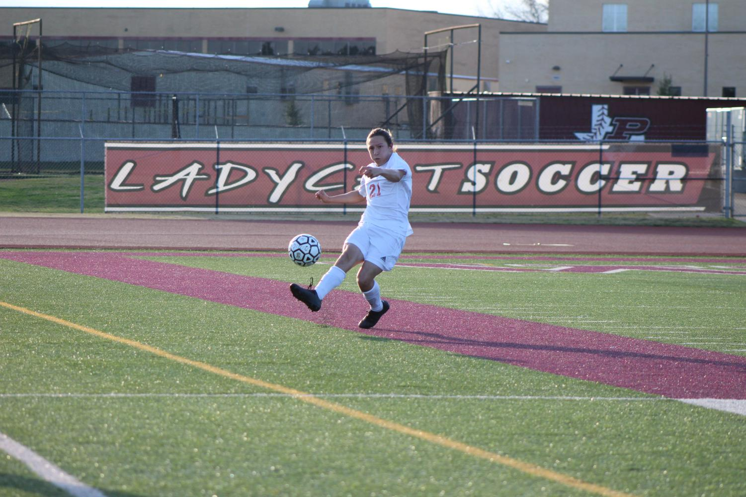 Senior Daniel Sifford kicks the ball off the field.