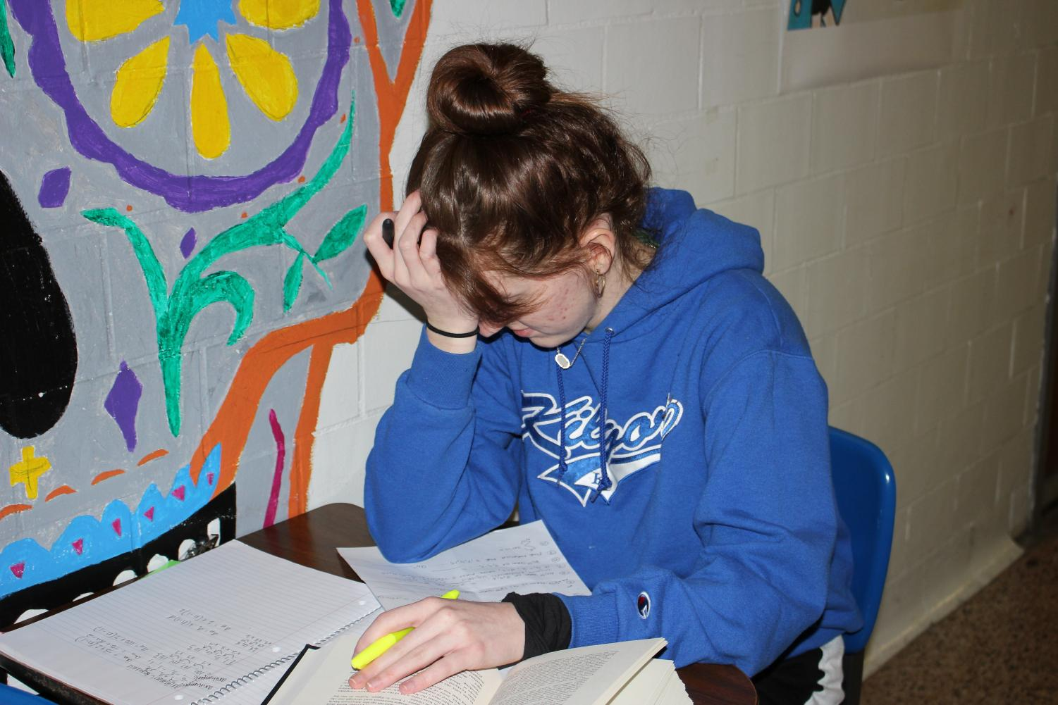 Junior Carlie Massey demonstrates how school and work can overwhelm students, leading to stress and mental breakdowns.