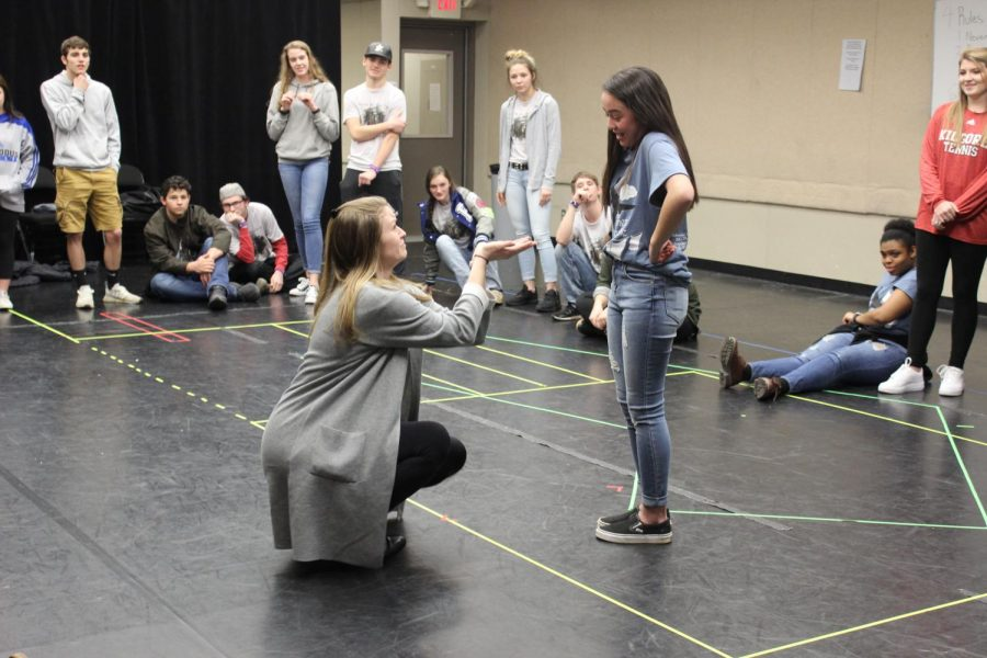 Theater+teacher+Sally+Wooddell+and+sophomore+Rachel+Bowman+participate+in+improve+games%2C+mimicking+a+proposal.+Photos+by+Katelynn+Knight.+