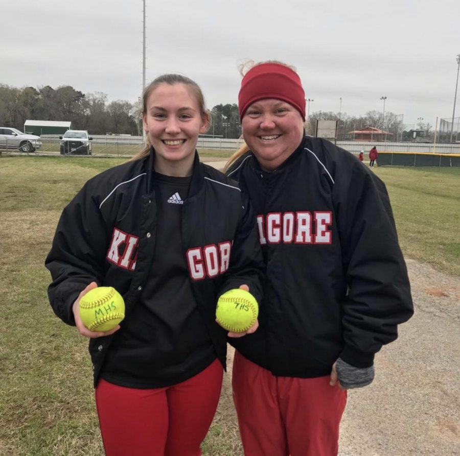 Coach+Kirkpatrick+and+sophomore+Bailey+Hedges+pose+with+her+home+run+softballs.++Courtesy+photo.%0A