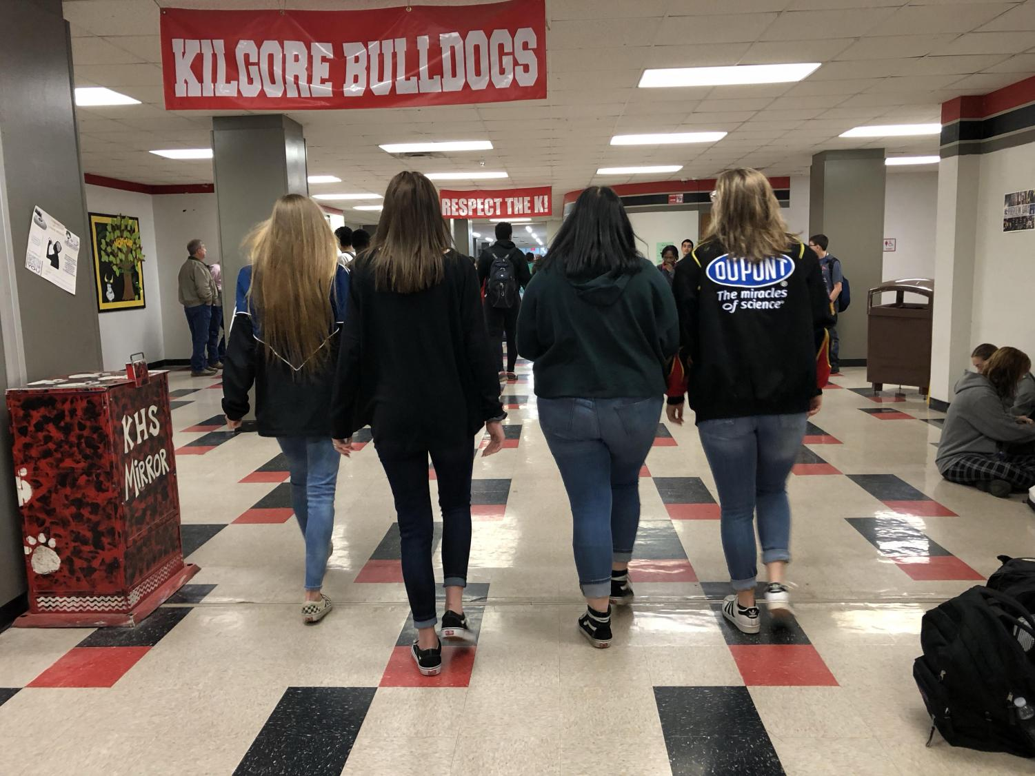 Sophomores Alexis M. Anderson, Halie Hanks, Carley Dollins and Shelby Maring walk away.