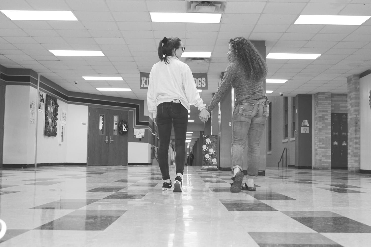 Sophomores Faith Jones and Olivia Arp demonstrate how to partake in a healthy, nontoxic friendship. Illustration photography.