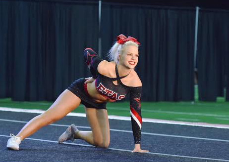Gracie performs in Fort Worth for her competition cheer team ETAS.