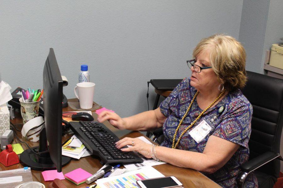 Marsha Edney works on her computer.