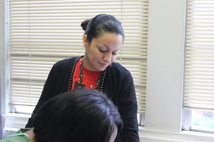 Rodriguez helps a student with her work.