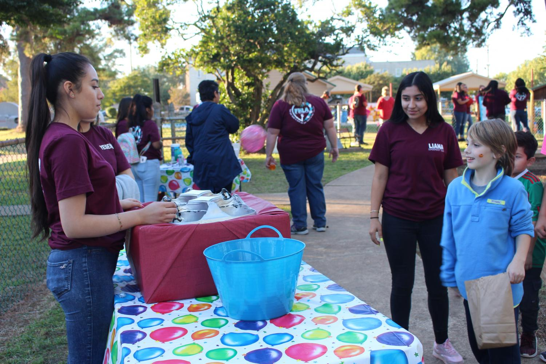 Leadership member, Junior Liana Huerta and Jimena Espinoza help the kids have a good time.