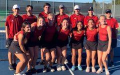 The tennis team celebrates their defeat against Crandall.