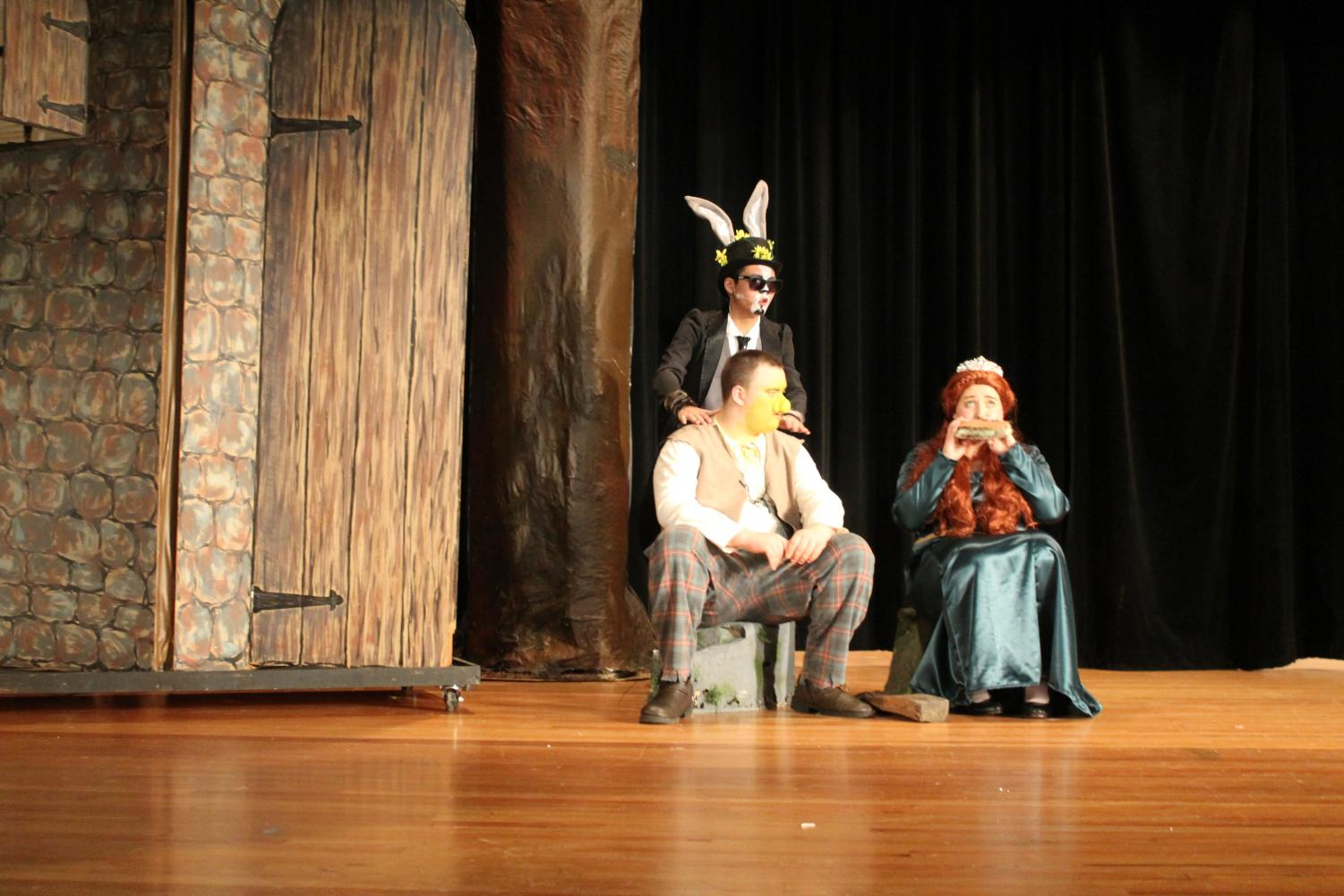 """Moving to the Music •  Seniors Madison Celley, junior James Mallick, and sophomore Bryan Harter perform the song """"Make a Move"""" from Shrek the Musical."""