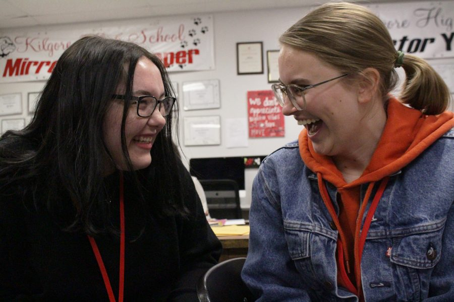 Junior Carley Dollins and freshman Olivia Blundell burst into laughter after a joke.