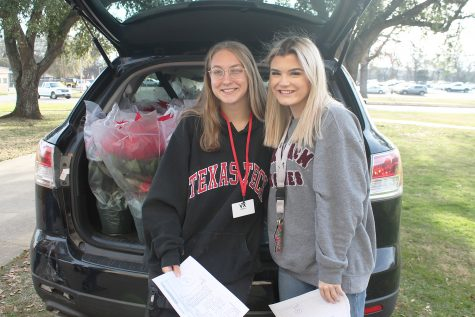 Juniors Shelby Maring and Carter Williams deliver their poinsettias together.