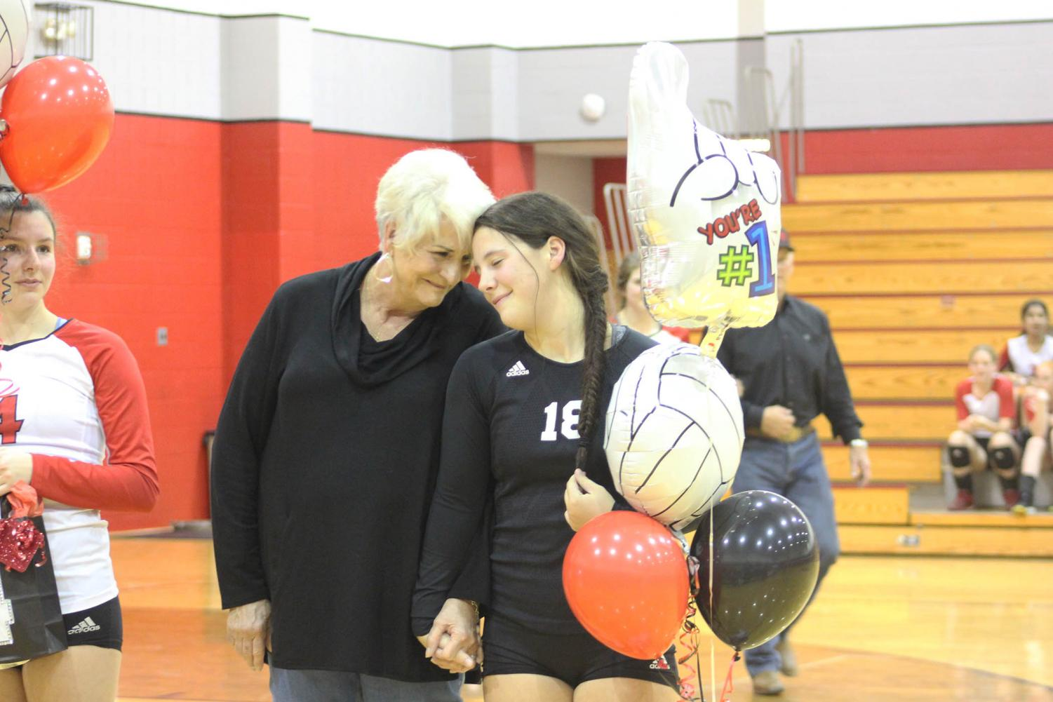 Senior Skyler Day and her grandmother Diana McGlasson share a moment on Senior Night for the volleyball team.