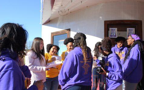 AASA members seniors Jessie  Villanueva, Kysiah Sept, Kaleigh Sammons, and junior Jaycie Villanueva interact with the community before the program.