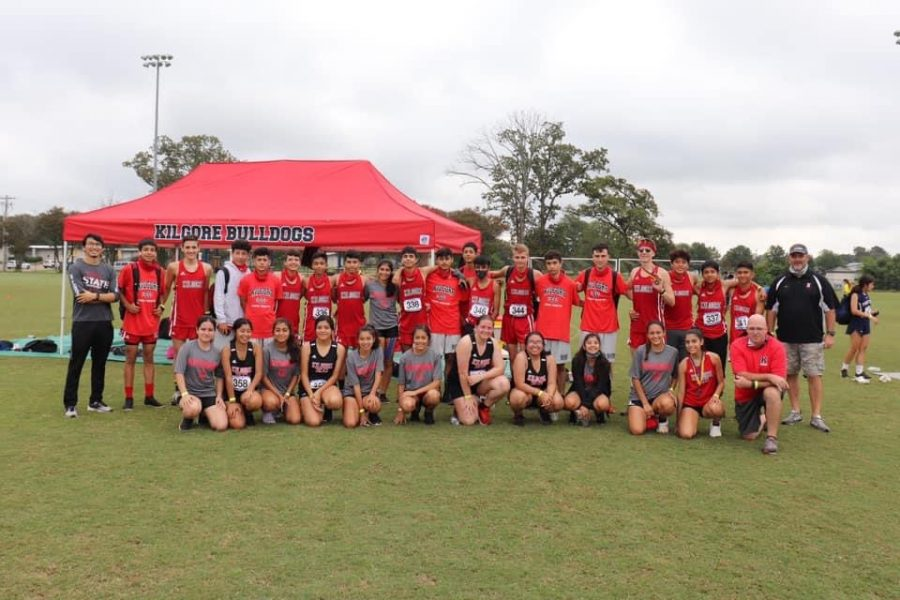Cross Country teams gather for a photo after receiving medals for their success.