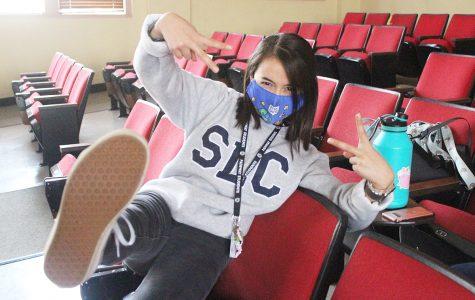 Senior Rachel Bowman hangs out with friends before class starts.