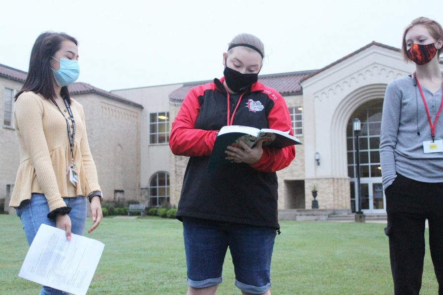 Seniors Rachel Bowman, Cerenity Exline, and Jayden Canwright give a message during See You at the Pole.