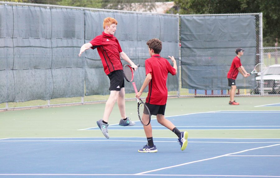Sophomores Grayson Cavel and Drew Adamez celebrate after a successful match.