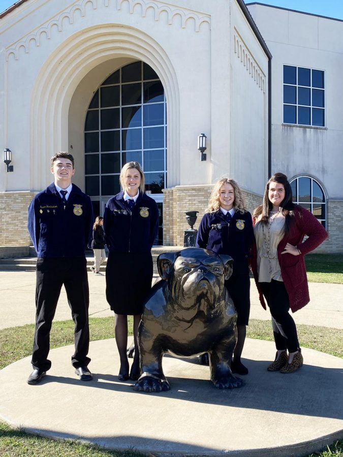 FFA sponsor Macie Wagstaff is photographed with the State Agriculture Advocacy team who competed.