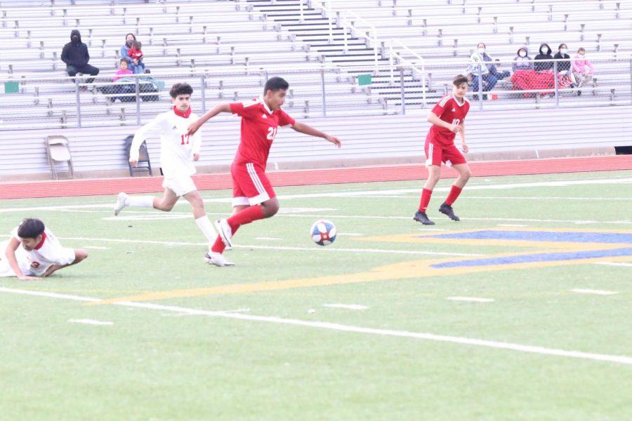 Freshmen Jacob Contreras gets past his defender.