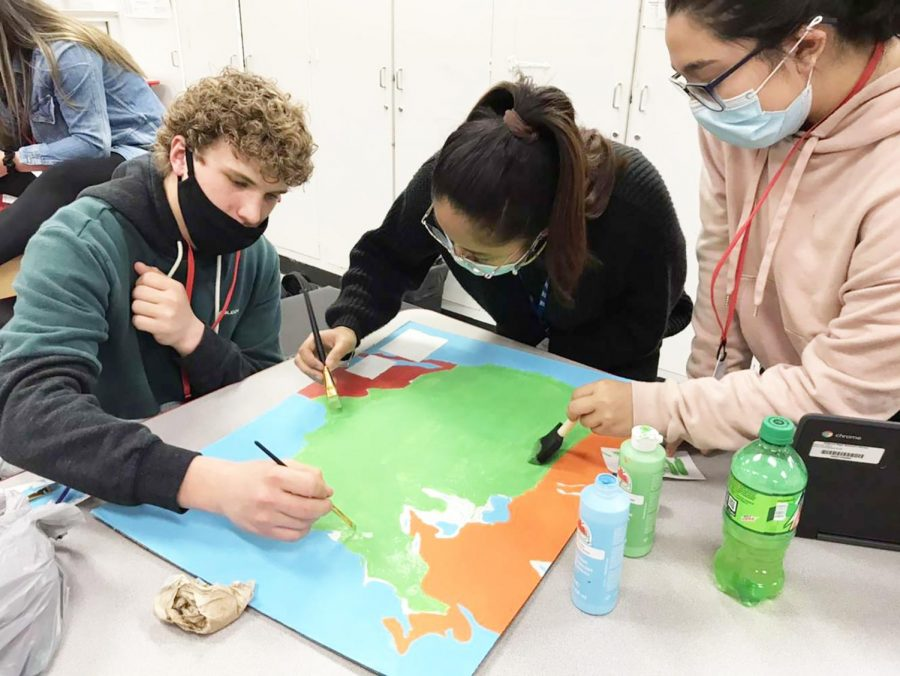 Juniors Cason Cox, Shanna Casayuran, Kendall Travino work on their map of the United States for Model UN.